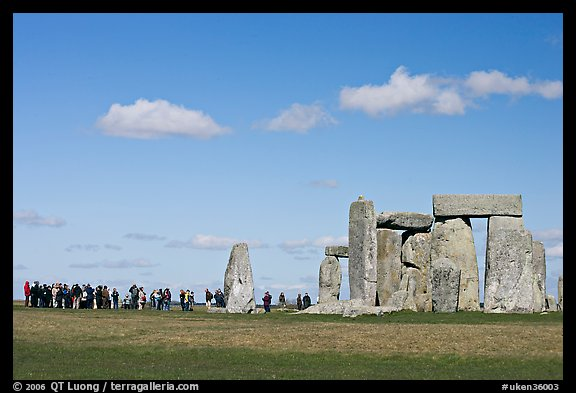 Large group of tourists looking at the standing stones, Stonehenge, Salisbury. England, United Kingdom