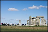 Large group of tourists looking at the standing stones, Stonehenge, Salisbury. England, United Kingdom (color)