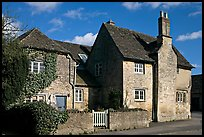 Houses with roofs made from split natural stone tiles, Lacock. Wiltshire, England, United Kingdom ( color)