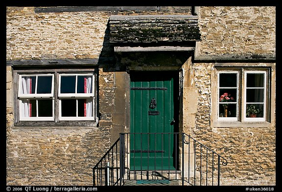 Windows and doorway entrance of stone house, Lacock. Wiltshire, England, United Kingdom (color)