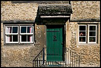 Windows and doorway entrance of stone house, Lacock. Wiltshire, England, United Kingdom ( color)