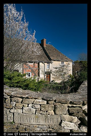 Stone wall with engraved street name, yard and house, Lacock. Wiltshire, England, United Kingdom (color)