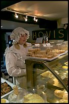 Woman wearing old-fashioned attire in a bakery, Lacock. Wiltshire, England, United Kingdom ( color)
