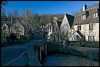 Packbridge crossing the Bybrook River and main street, Castle Combe. Wiltshire, England, United Kingdom (color)