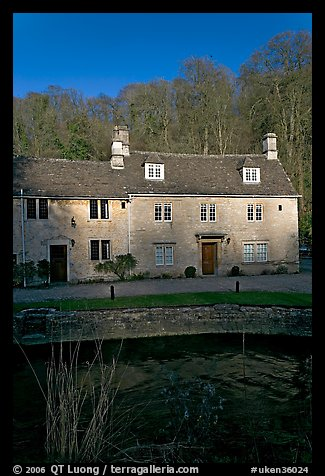 Cotswold type houses and Bybrook River, Castle Combe. Wiltshire, England, United Kingdom (color)
