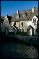 Cotswold type cottages and Bybrook River, Castle Combe. Wiltshire, England, United Kingdom