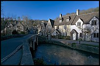 Main village street and Bybrook River, late afternoon, Castle Combe. Wiltshire, England, United Kingdom ( color)