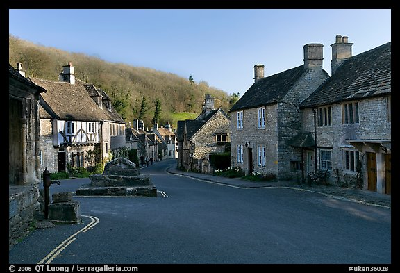 Main village street,  half timbered Court House, and Butter Cross, Castle Combe. Wiltshire, England, United Kingdom (color)
