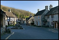 Main village street,  half timbered Court House, and Butter Cross, Castle Combe. Wiltshire, England, United Kingdom