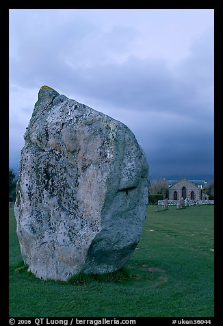 Standing stone and chapel at dusk, Avebury, Wiltshire. England, United Kingdom