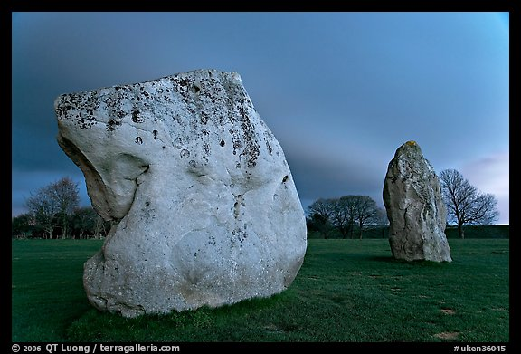 Large standing stones and brewing storm at dusk, Avebury, Wiltshire. England, United Kingdom (color)