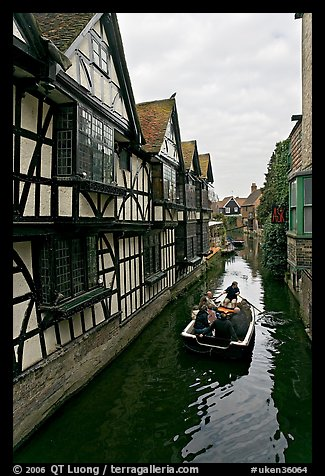 Half-timbered house, canal, and rowboat. Canterbury,  Kent, England, United Kingdom