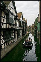 Half-timbered house, canal, and rowboat. Canterbury,  Kent, England, United Kingdom (color)