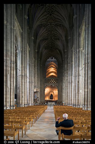 Man sitting in the Nave of the Canterbury Cathedral. Canterbury,  Kent, England, United Kingdom (color)