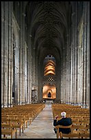 Man sitting in the Nave of the Canterbury Cathedral. Canterbury,  Kent, England, United Kingdom ( color)
