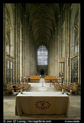 Altar, soaring arches of the Nave, and stained glass, Canterbury Cathedral. Canterbury,  Kent, England, United Kingdom
