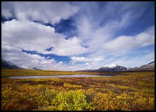 Clouds, tundra, and lake along Denali Highway in autumn. Alaska, USA