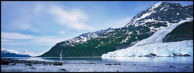 Landscape with tidewater glacier and waterfall. Prince William Sound, Alaska, USA (Panoramic color)