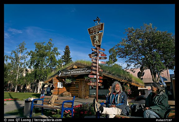 Native people sitting in front of visitor center. Anchorage, Alaska, USA