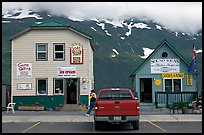 Cabins on the waterfront and red truck. Whittier, Alaska, USA (color)