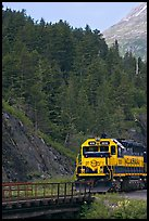 Locomotive and forest. Whittier, Alaska, USA (color)