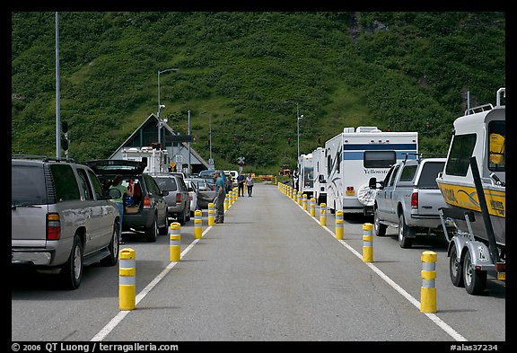 Cars and RVs lining up for the tunnel crossing. Whittier, Alaska, USA (color)