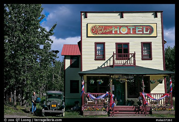 Small hotel with classic car parked by, afternoon. McCarthy, Alaska, USA