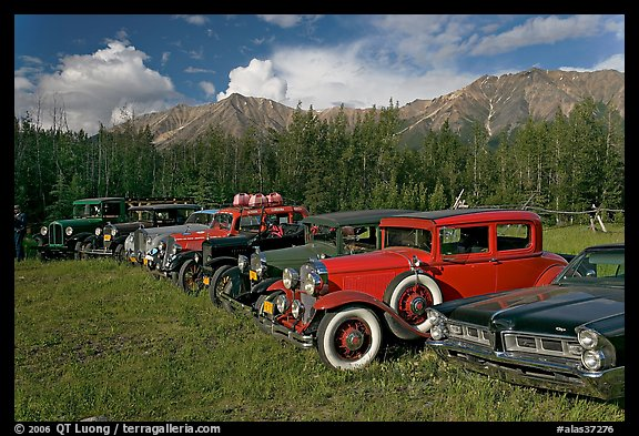 Vintage cars lined up in meadow. McCarthy, Alaska, USA (color)