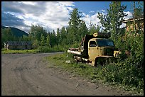 Side street with wrecked truck. McCarthy, Alaska, USA ( color)