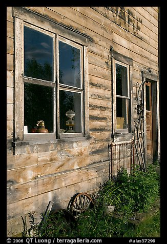 Windows and doors of old wooden building. McCarthy, Alaska, USA (color)