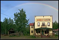 Rainbow over the historic Ma Johnson hotel building. McCarthy, Alaska, USA (color)