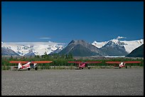 Bush planes on McCarthy airfield  and Wrangell range. McCarthy, Alaska, USA (color)