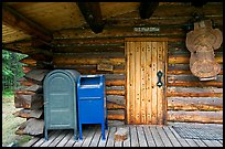 Mail boxes, log house post office, Slana. Alaska, USA (color)