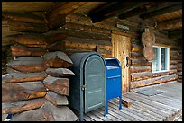 Mail boxes, log house postal office, Slana. Alaska, USA (color)