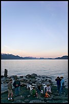 Family enjoying midnight picknik, Resurrection Bay, sunset. Seward, Alaska, USA ( color)