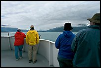 Passengers standing on deck with colorful  clothes. Seward, Alaska, USA ( color)