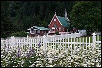 Flowers, white picket fence and church. Seward, Alaska, USA