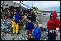 Inupiaq Eskimo family with stand of drying fish, Ambler. North Western Alaska, USA (color)