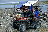 Inupiaq Eskimo man and woman riding on a four-wheeler, Ambler. North Western Alaska, USA