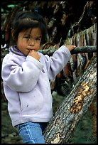 Inupiaq Eskimo girl near drying fish, Ambler. North Western Alaska, USA