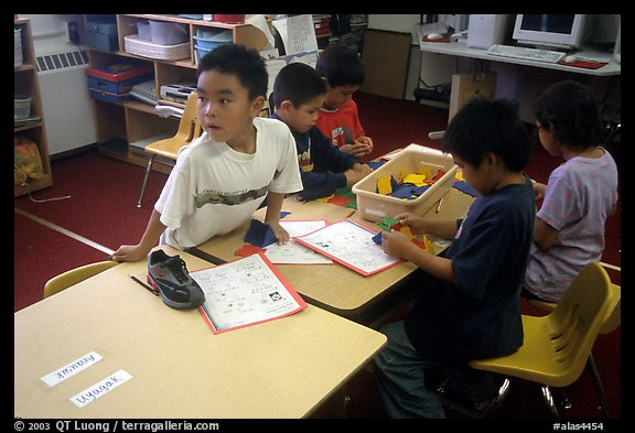 Inupiaq Eskimo kids in the classroom. Note names on table. Kiana. North Western Alaska, USA (color)
