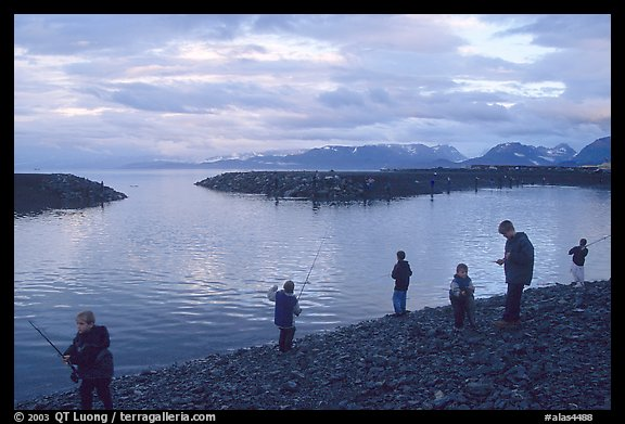 Fishing for salmon in the Spit's Fishing Hole. Homer, Alaska, USA