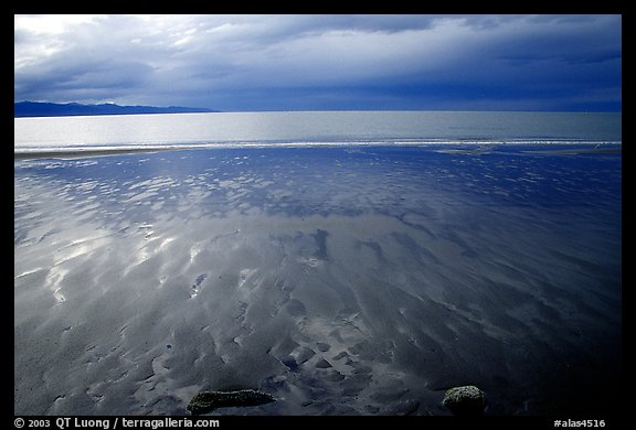 Sand patterns and stormy skies on the Bay. Homer, Alaska, USA (color)