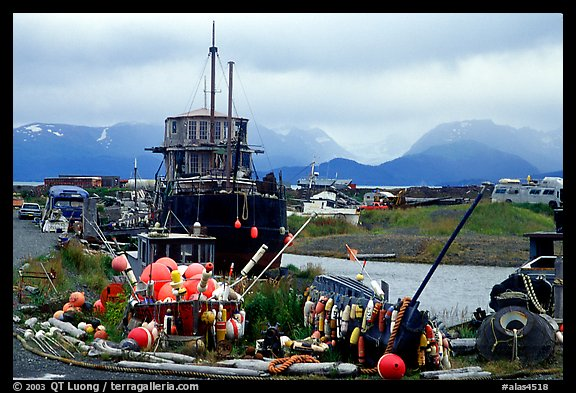 Retired fishing boat with a pile of marine gear on the Spit. Homer, Alaska, USA (color)