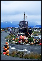 Retired fishing boat with a pile of marine gear on the Spit. Homer, Alaska, USA ( color)