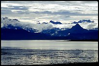 Low clouds haning over Kenai Mountains across Katchemak Bay. Homer, Alaska, USA
