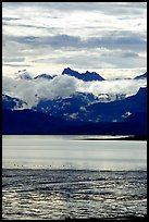 Low clouds hanging over Kenai Mountains across Katchemak Bay. Homer, Alaska, USA ( color)