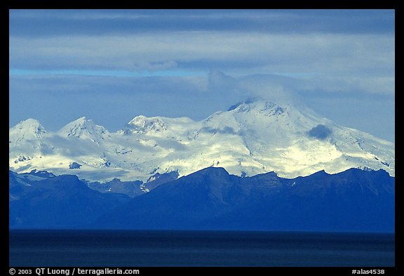 Mt Iliamna, a volcano in Lake Clark National Park, seen across the Cook Inlet. Ninilchik, Alaska, USA