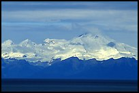 Mt Iliamna, a volcano in Lake Clark National Park, seen across the Cook Inlet. Ninilchik, Alaska, USA (color)
