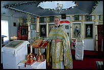 Orthodox priest inside the old Russian church. Ninilchik, Alaska, USA